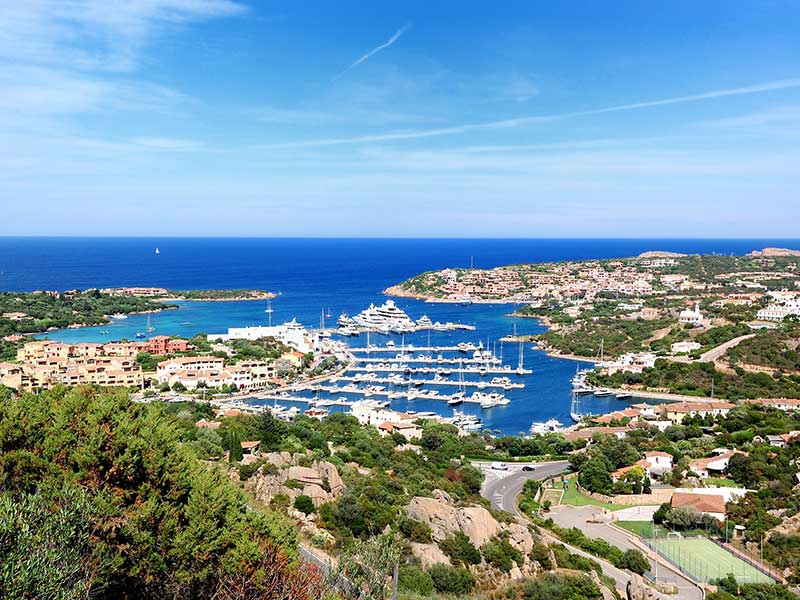 chemtrails included in a publicity shot, costa_smeralda_porto_cervo Sardinia